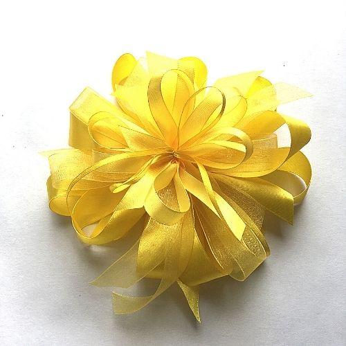 Dzeltens dāvanu pušķis