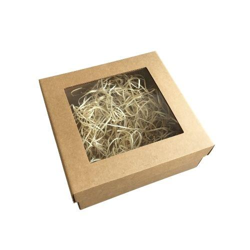 Kartona kaste ar caurspīdīgu vāciņu un koka skaidu pildījumu